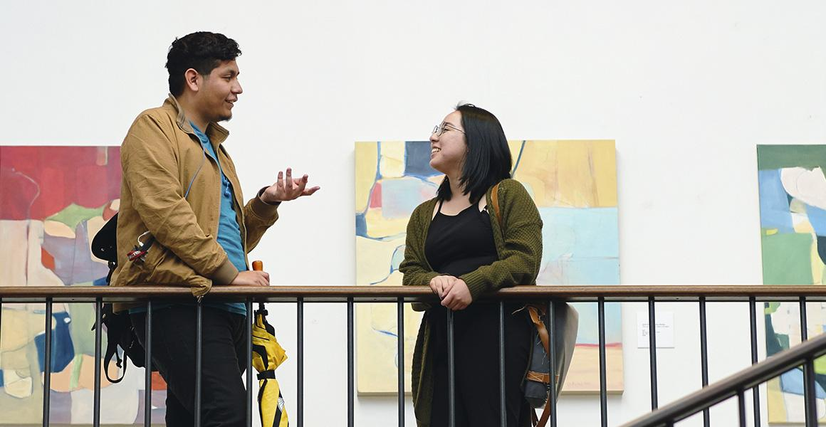 students talking in a gallery