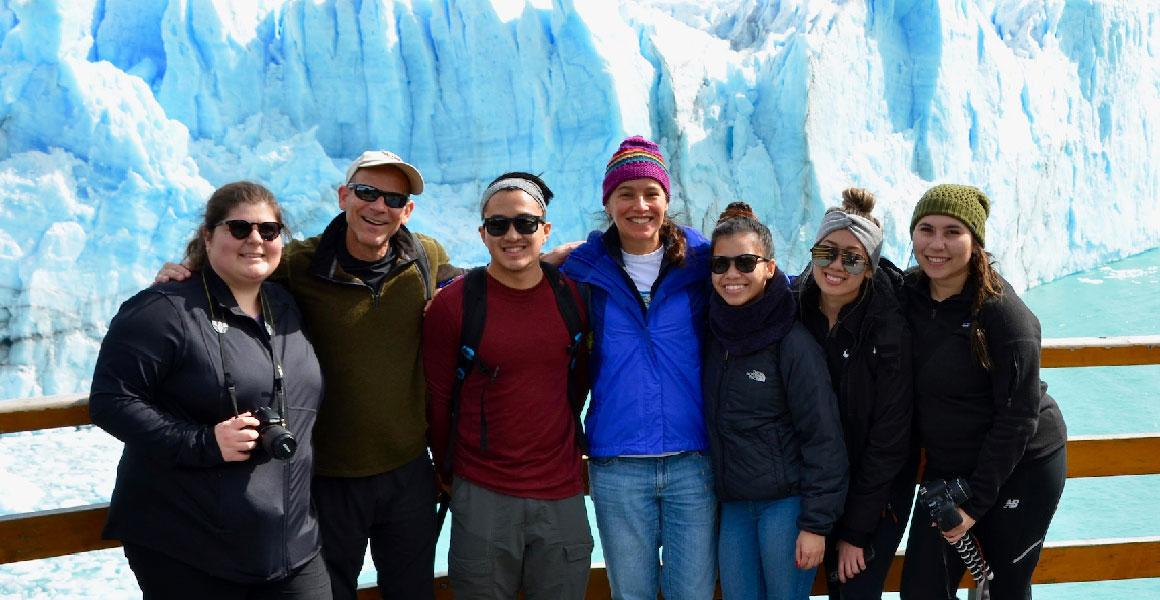 students in front of an iceberg in patagonia