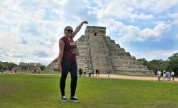 dominican student in front of pyramid in mexico