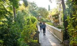 Students walking across a wooden bridge on the Dominican campus