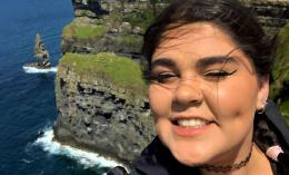 photo of OT student Julia Zasso above coast side cliff in Ireland