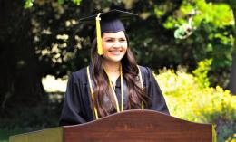 photo of Vanessa Groppetti '21, in cap and gown, taping baccalaureate address