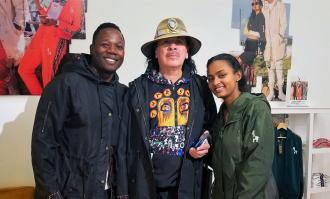 yema klalif and hawi awash pose with carlos santana at tiburon store