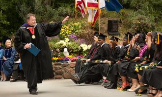 past president joe fink at 2011 commencement at forest meadow amphitheater