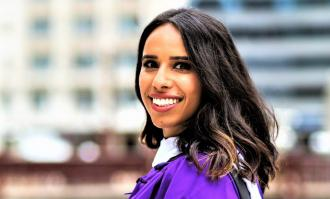 Dominican alumna Navi Dhaliwal in purple Northwestern University graduation gown