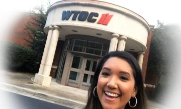 Selfie photo of Amanda Aguilar '13 smiling outside WTOC for Homepage image