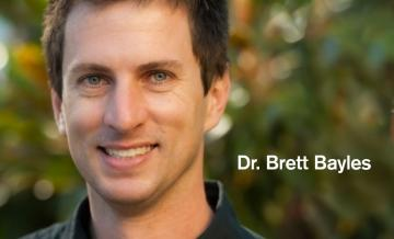 Headshot Photo of Global Public Health Professor Brett Bayles