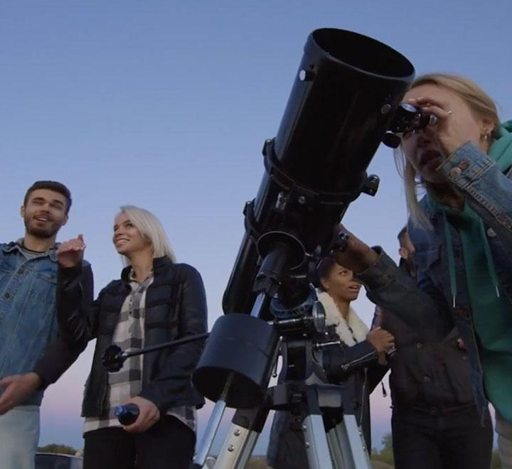 Dominican University of California students using telescope
