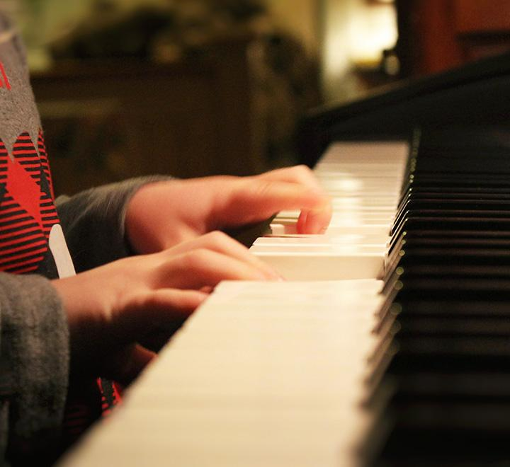 young piano player at the keyboard