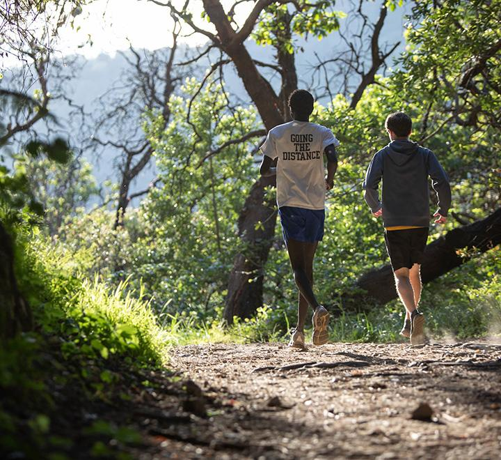 students running on trails at Dominican University
