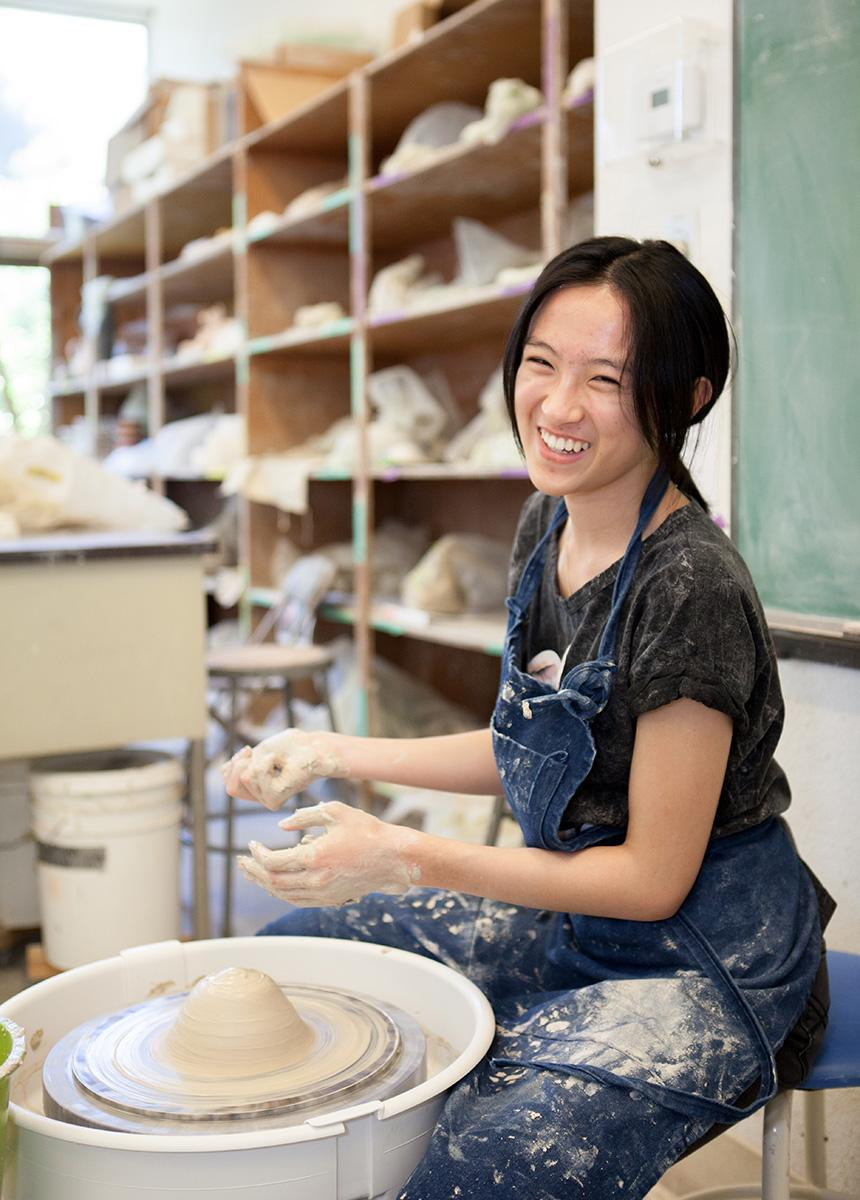 student in ceramic studio
