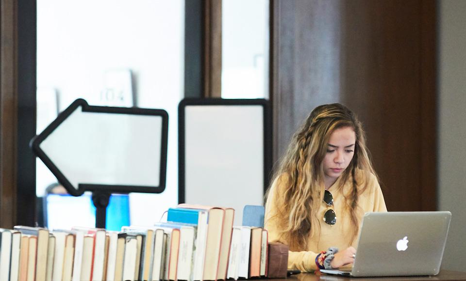 generic image of student in alemany library for duc mcoe news story