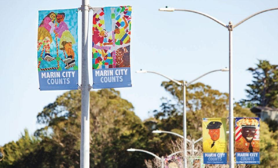 image of street light banners created by art students for Marin City Counts Census 2020 campaign